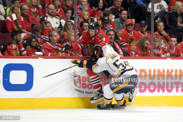 Chicago Blackhawks right wing Richard Panik battles with Nashville Predators center Kevin Fiala in the third period during game 2 of the first round...