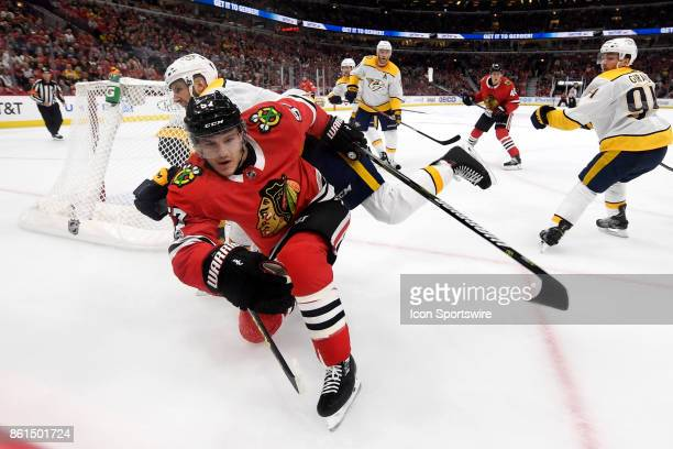 Chicago Blackhawks right wing Tommy Wingels battles for a loose puck during a game between the Chicago Blackhawks and the Nashville Predators on...