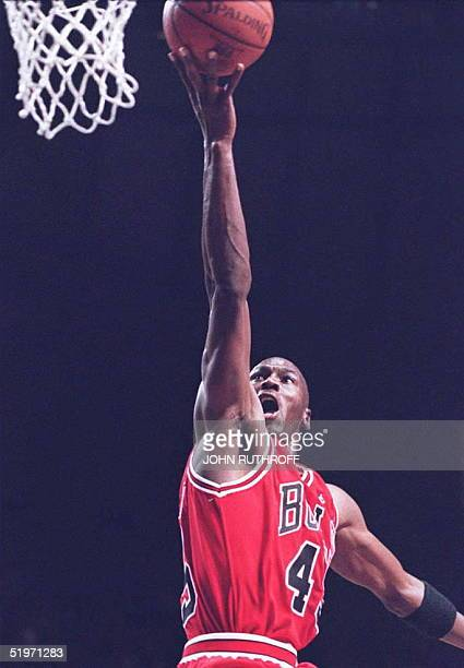 Chicago Bulls basketball star Michael Jordan goes up for a shot in the second half 19 March against the Indiana Pacers at Market Square Arena in...