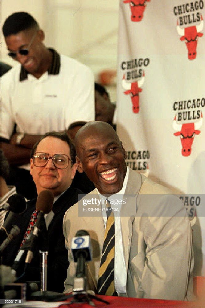 Chicago Bulls basketball star <a gi-track='captionPersonalityLinkClicked' href=/galleries/search?phrase=Michael+Jordan+-+Basketball+Player&family=editorial&specificpeople=73625 ng-click='$event.stopPropagation()'>Michael Jordan</a> (R) laughs during a press conference 06 October 1993 as he announces his retirement from the game. At left, sitting is Bulls' owner Jerry Reinsdorf and standing, Bulls player Scottie Pippen.