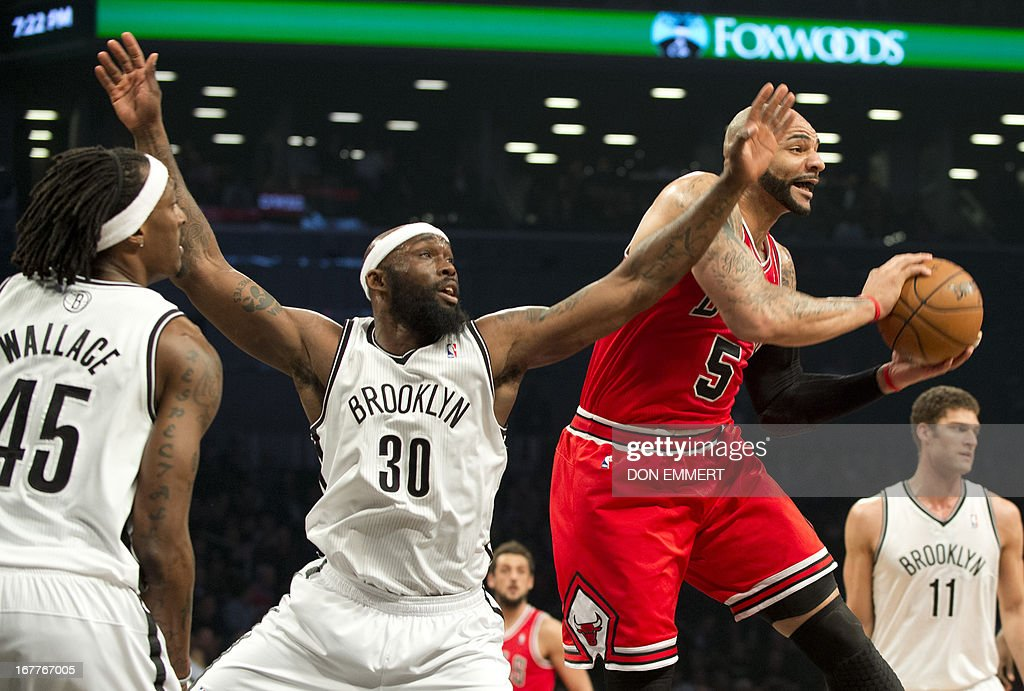 Chicago Bulls Carlos Boozer (5) comes down witrh a rebound next to Brooklyn Nets Reggie Evans (30) during game five of their first round NBA playoff game April 29, 2013 at the Barclay Center in New York. AFP PHOTO/Don Emmert