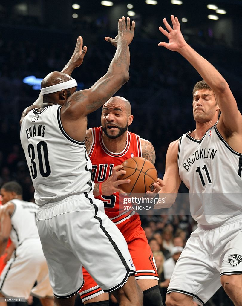 Chicago Bulls Carlos Boozer drives against Brooklyn Nets Brook Lopez (11) and Reggie Evans (30) during Game 7 of the Eastern Conference quarterfinals at the Barclays Center on May 4 , 2013 in the Brooklyn borough of New York City.