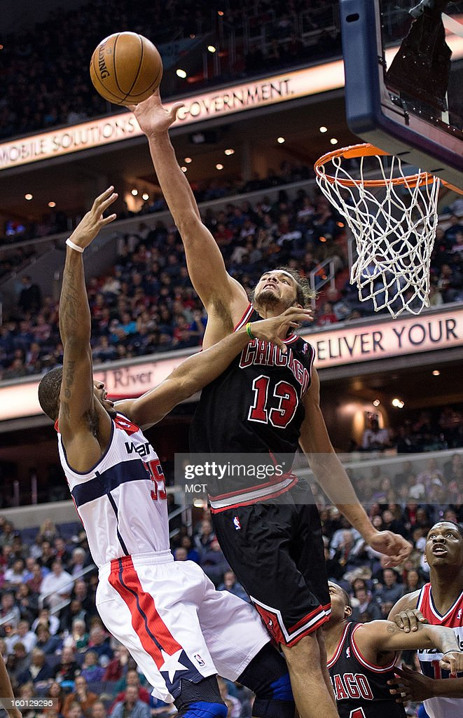 Chicago Bulls center Joakim Noah (13) blocks the shot of Washington Wizards power forward Trevor Booker (35) during the second half of their game played at the Verizon Center in Washington, D.C., Saturday, January 26, 2013. Washington defeated Chicago 86-73.