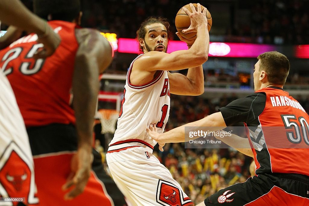 Chicago Bulls center Joakim Noah (13) looks for an open teammate during the second half against the Toronto Raptors at the United Center in Chicago, Saturday, Dec. 14, 2013. The Raptors defeated the Bulls, 99-77.