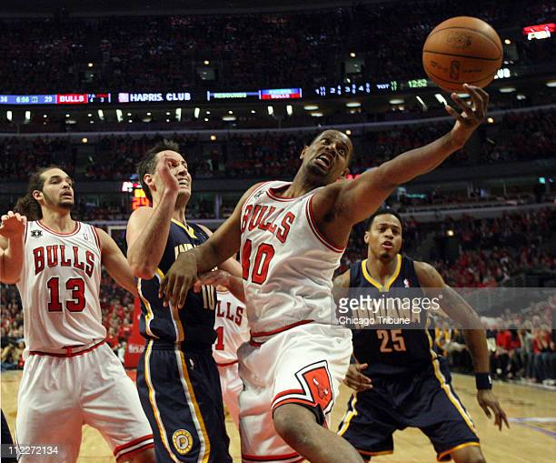 Chicago Bulls center Kurt Thomas grabs a rebound in front of Indiana Pacers center Jeff Foster during secondhalf action in Game 1 of the NBA Eastern...