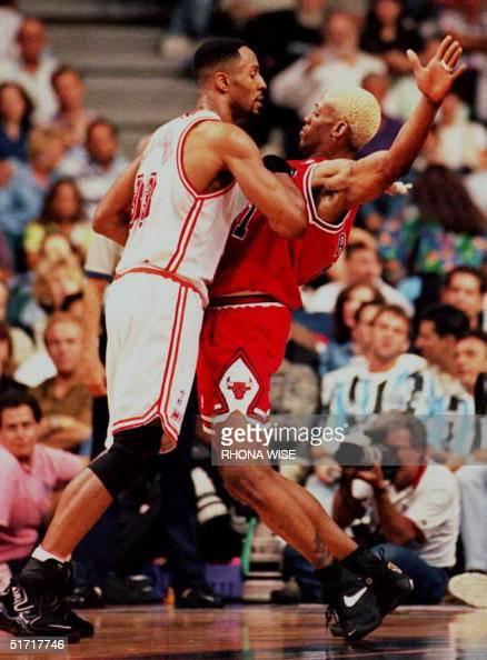 Chicago Bulls' Dennis Rodman (R) and Miami Heat pl ...