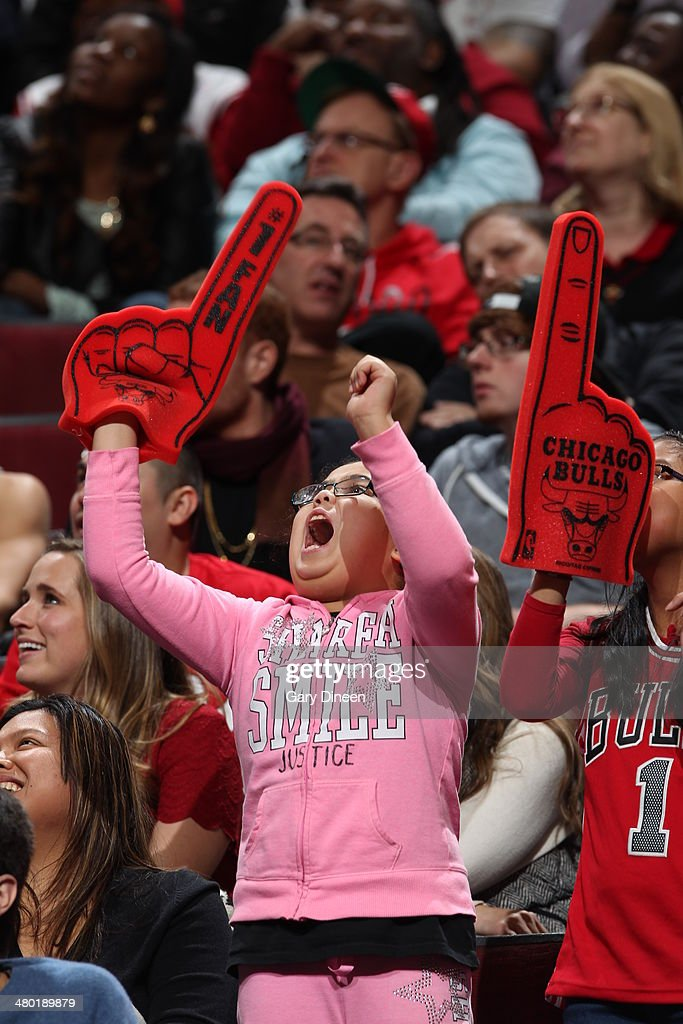 A Chicago Bulls fan cheers during a game against the New Orleans Pelicans on December 2, 2013 at the United Center in Chicago, Illinois.