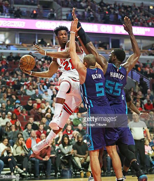 Chicago Bulls forward Jimmy Butler makes a pass around Charlotte Hornets guard Nicolas Batum and center Roy Hibbert during the first half on Monday...