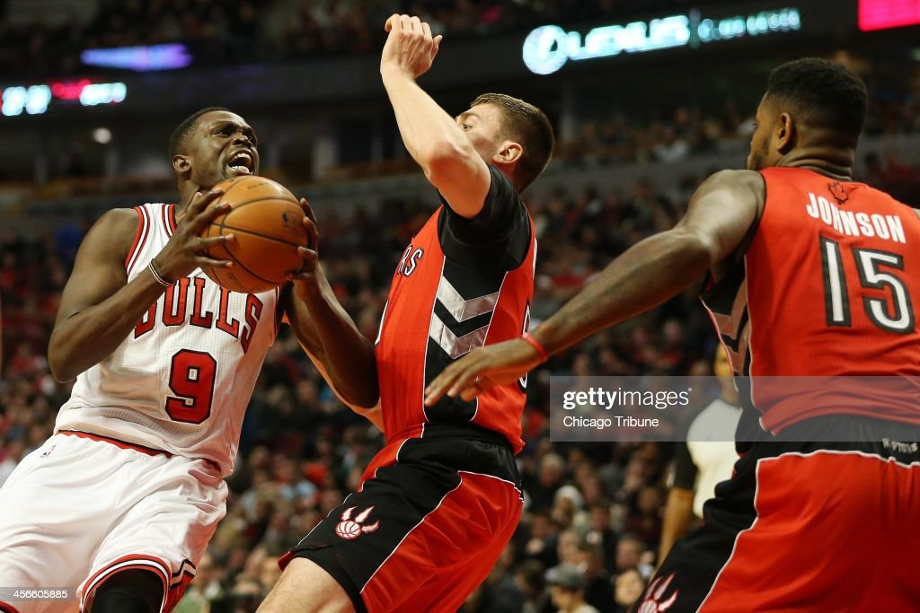 Chicago Bulls forward Luol Deng (9) drives toward the basket against Toronto Raptors forward Austin Daye (5) in the second half at the United Center in Chicago, Saturday, Dec. 14, 2013. The Raptors defeated the Bulls, 99-77.