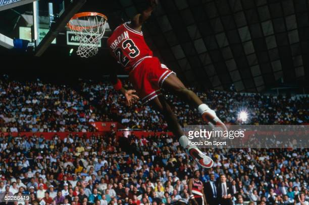 Chicago Bulls' forward Michael Jordan dunks as the crowd takes photos during a game against the Portland Trail Blazers circa 19841998