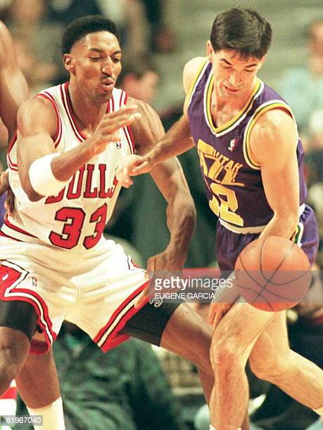 Chicago Bulls forward Scottie Pippen knocks the ball away from Utah Jazz guard John Stockton 17 December during the first quarter of their NBA game...