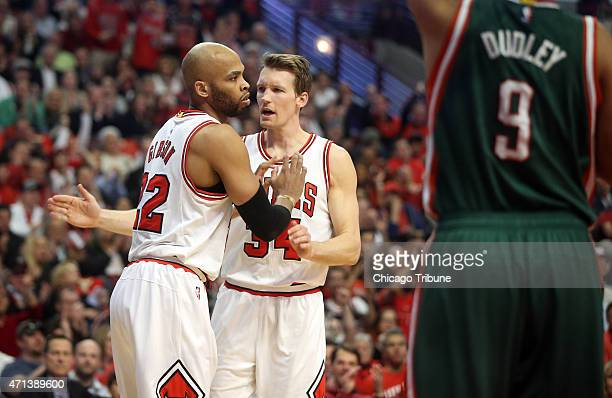Chicago Bulls forward Taj Gibson and forward Mike Dunleavy celebrate during the first half on Monday April 27 at the United Center in Chicago in Game...