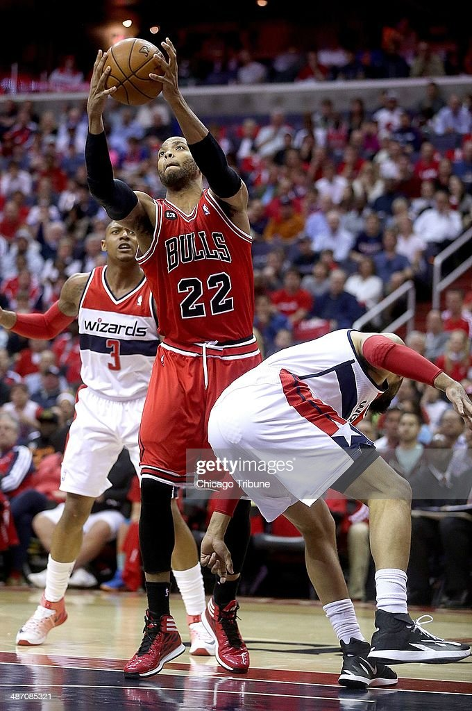Chicago Bulls forward Taj Gibson (22) pulls down a rebound over Washington Wizards forward Drew Gooden (90) during the first half of their first round playoff game played at the Verizon Center in Washington, Sunday, Apr. 27, 2014.