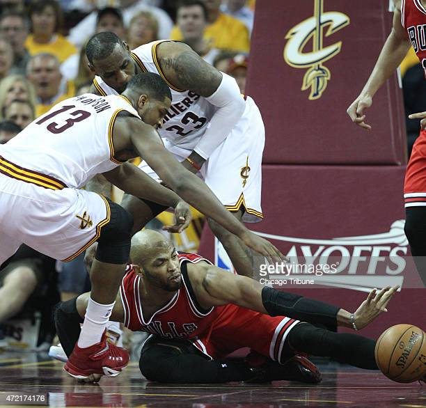 Chicago Bulls forward Taj Gibson reaches for a loose ball during the second quarter of Game 1 of the Eastern Conference semifinals on Monday May 4 at...