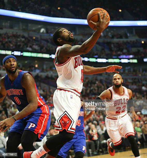 Chicago Bulls guard Aaron Brooks makes a basket in front of Detroit Pistons center Andre Drummond during the first half on Monday Nov 10 at the...