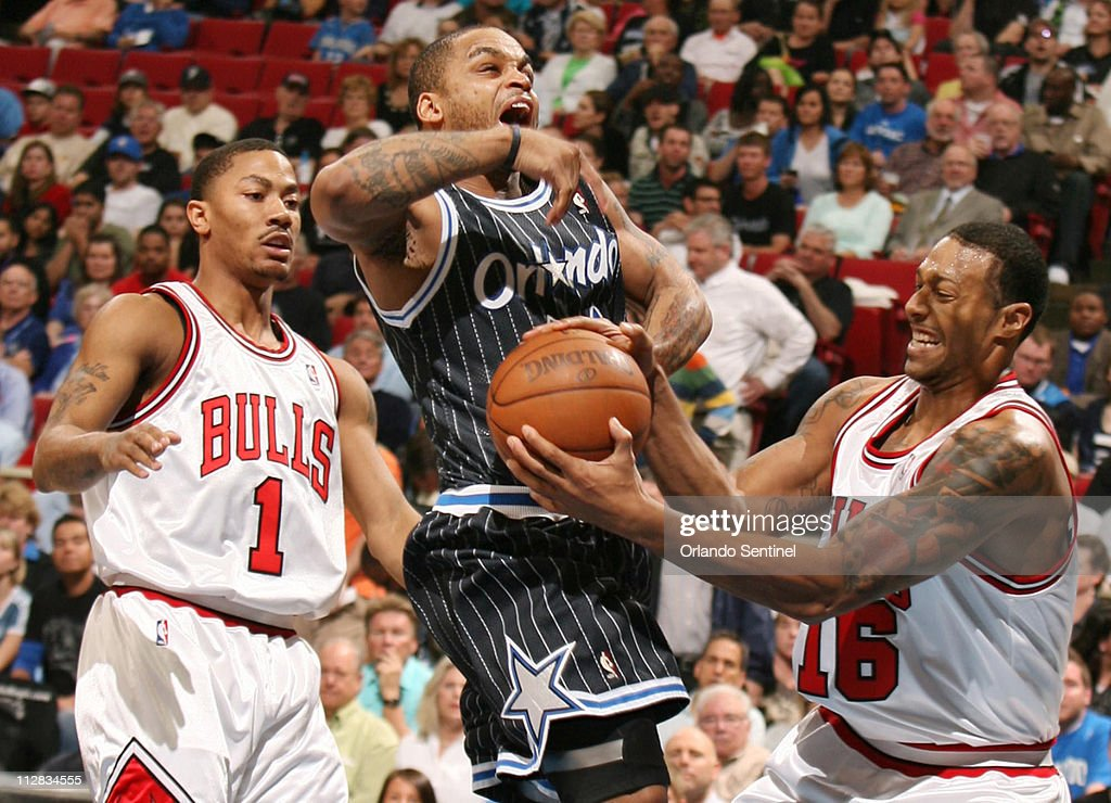 Chicago Bulls guard Derrick Rose and forward James Johnson defends against Orlando Magic guard Jameer Nelson during an NBA game at Amway Arena in...