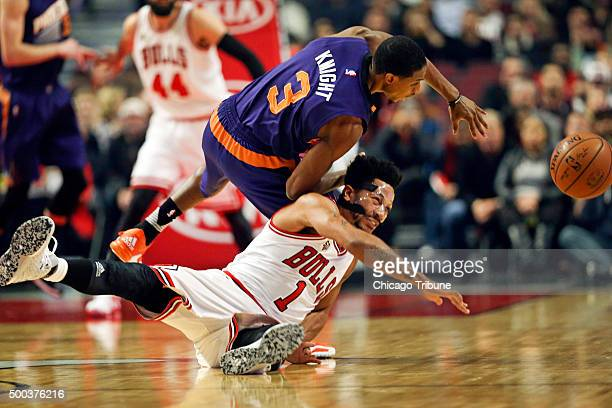 Chicago Bulls guard Derrick Rose and Phoenix Suns guard Brandon Knight go after a loose ball during the first half on Monday Dec 7 at the United...