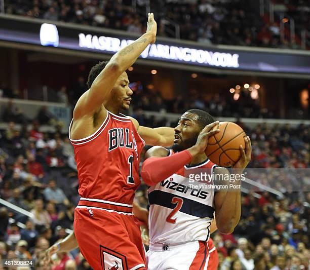 Chicago Bulls guard Derrick Rose defends Washington Wizards guard John Wall on January 9 2015 in Washington DC