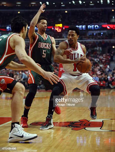 Chicago Bulls guard Derrick Rose drives against Milwaukee Bucks guard Michael CarterWilliams during the first half on Monday April 20 at the United...