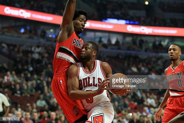 Chicago Bulls guard Dwyane Wade drives against Portland Trail Blazers forward Ed Davis during the first half on Monday Dec 5 2016 at the United...