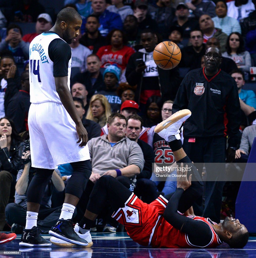 Chicago Bulls guard Dwyane Wade, right, rubs his right leg after being injured on a scramble for the ball during second half action on Monday, March 13, 2017 at the Spectrum Center in Charlotte, N.C. Charlotte Hornets forward Michael Kidd-Gilchrist, right, looks on. Wade would return to action. The Bulls defeated the Hornets 115-109.
