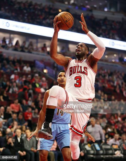 Chicago Bulls guard Dwyane Wade shoots as Denver Nuggets guard Gary Harris looks on during the first half on Tuesday Feb 28 2017 at the United Center...