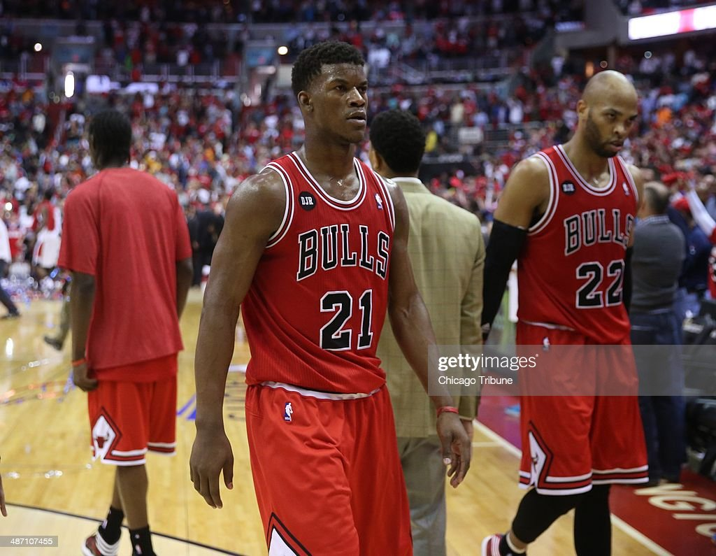 Chicago Bulls guard <a gi-track='captionPersonalityLinkClicked' href=/galleries/search?phrase=Jimmy+Butler+-+Basketball+Player&family=editorial&specificpeople=9860567 ng-click='$event.stopPropagation()'>Jimmy Butler</a> (21) and forward Taj Gibson (22) leave the court following their lost to the Washington Wizards in the first round of the playoffs at the Verizon Center in Washington, Sunday, Apr. 27, 2014. Washington defeated Chicago 98-89 to take a 3-1 lead in the series.