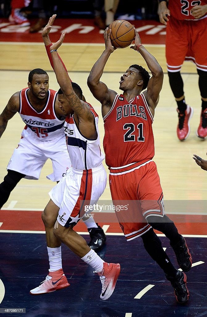 Chicago Bulls guard <a gi-track='captionPersonalityLinkClicked' href=/galleries/search?phrase=Jimmy+Butler+-+Basketball+Player&family=editorial&specificpeople=9860567 ng-click='$event.stopPropagation()'>Jimmy Butler</a> (21) drives around Washington Wizards guard Bradley Beal (3) for a shot during the second half of their first round playoff game played at the Verizon Center in Washington, Sunday, Apr. 27, 2014.