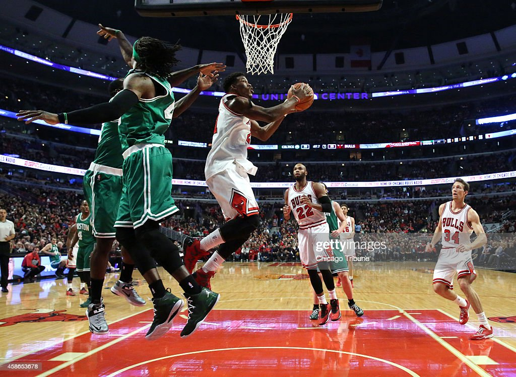 Chicago Bulls guard <a gi-track='captionPersonalityLinkClicked' href=/galleries/search?phrase=Jimmy+Butler+-+Basketball+Player&family=editorial&specificpeople=9860567 ng-click='$event.stopPropagation()'>Jimmy Butler</a> (21) eludes two Boston Celtics defenders during the first half on Saturday, Nov. 8, 2014, at the United Center in Chicago.
