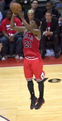Chicago Bulls guard Jimmy Butler hits a threepoint shot late in the game against the Washington Wizards during the second half of their first round...