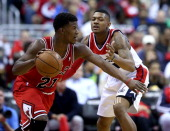 Chicago Bulls guard Jimmy Butler is defended by Washington Wizards guard Bradley Beal during the second half of their first round playoff game played...