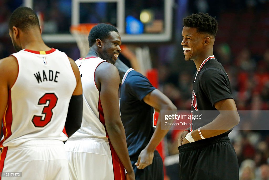 Chicago Bulls guard <a gi-track='captionPersonalityLinkClicked' href=/galleries/search?phrase=Jimmy+Butler+-+Basketball+Player&family=editorial&specificpeople=9860567 ng-click='$event.stopPropagation()'>Jimmy Butler</a> (21) laughs as he chats with Miami Heat forward <a gi-track='captionPersonalityLinkClicked' href=/galleries/search?phrase=Luol+Deng&family=editorial&specificpeople=202830 ng-click='$event.stopPropagation()'>Luol Deng</a> (9) at the start of the game on Sunday, Jan. 25, 2015, at the United Center in Chicago.