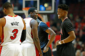 Chicago Bulls guard Jimmy Butler laughs as he chats with Miami Heat forward Luol Deng at the start of the game on Sunday Jan 25 at the United Center...