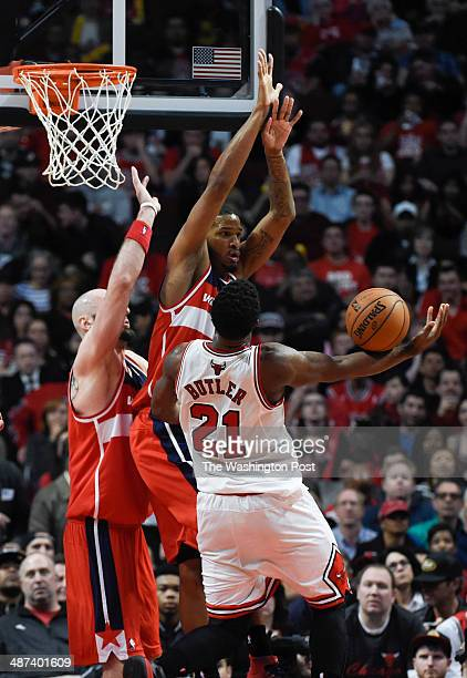 Chicago Bulls guard Jimmy Butler loses the ball as Washington Wizards center Marcin Gortat and Washington Wizards forward Trevor Ariza defend the...