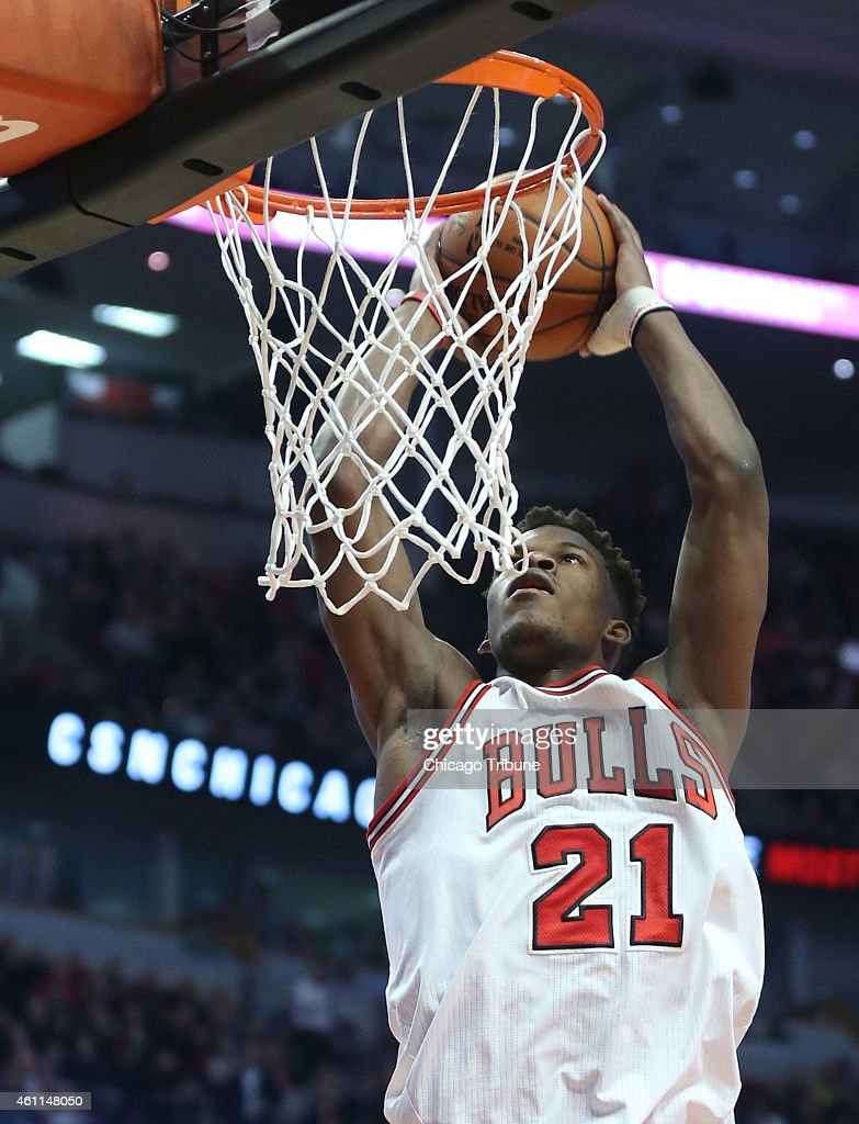 Chicago Bulls guard <a gi-track='captionPersonalityLinkClicked' href=/galleries/search?phrase=Jimmy+Butler+-+Basketball+Player&family=editorial&specificpeople=9860567 ng-click='$event.stopPropagation()'>Jimmy Butler</a> (21) rises for a dunk during the third quarter on Wednesday, Jan. 7, 2015, at the United Center in Chicago.
