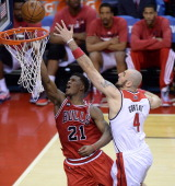 Chicago Bulls guard Jimmy Butler scores against Washington Wizards center Marcin Gortat during the second half of their first round playoff game...