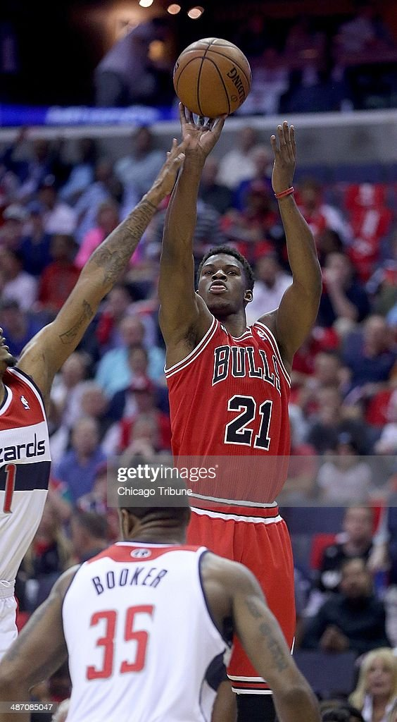 Chicago Bulls guard <a gi-track='captionPersonalityLinkClicked' href=/galleries/search?phrase=Jimmy+Butler+-+Basketball+Player&family=editorial&specificpeople=9860567 ng-click='$event.stopPropagation()'>Jimmy Butler</a> (21) shoots over Washington Wizards forward Trevor Ariza (1) during the first half of their first round playoff game played at the Verizon Center in Washington, Sunday, Apr. 27, 2014.