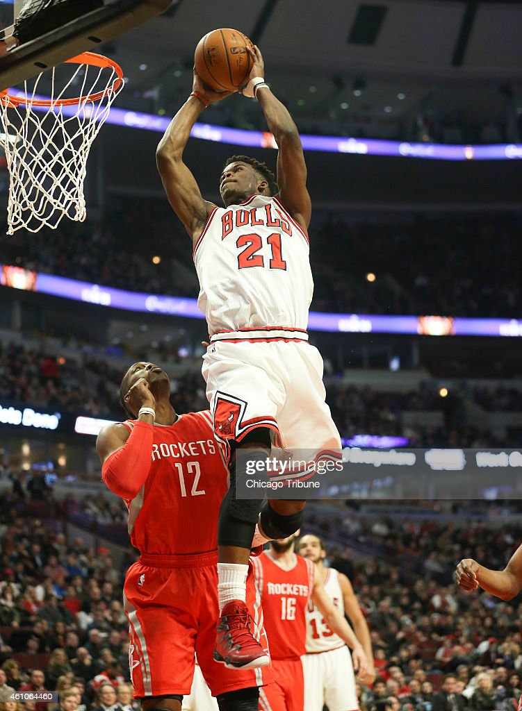 Chicago Bulls guard <a gi-track='captionPersonalityLinkClicked' href=/galleries/search?phrase=Jimmy+Butler+-+Basketball+Player&family=editorial&specificpeople=9860567 ng-click='$event.stopPropagation()'>Jimmy Butler</a> (21) slams an alley-oop pass from Chicago Bulls guard <a gi-track='captionPersonalityLinkClicked' href=/galleries/search?phrase=Derrick+Rose&family=editorial&specificpeople=4212732 ng-click='$event.stopPropagation()'>Derrick Rose</a> (1) during the first half on Monday, Jan. 5, 2015, at the United Center in Chicago.