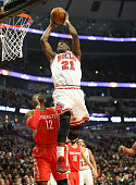 Chicago Bulls guard Jimmy Butler slams an alleyoop pass from Chicago Bulls guard Derrick Rose during the first half on Monday Jan 5 at the United...