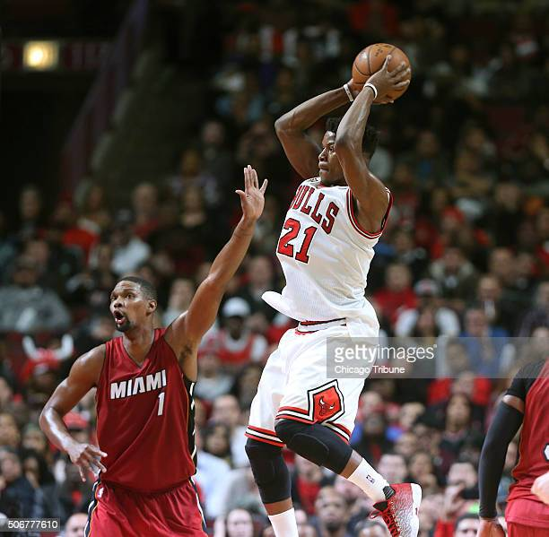 Chicago Bulls guard Jimmy Butler with a pass near Miami Heat forward Chris Bosh during the second half on Monday Jan 25 at the United Center in...