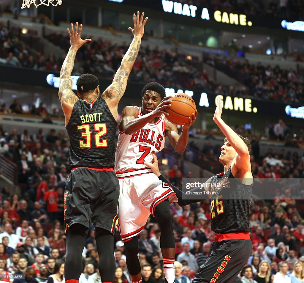 Chicago Bulls guard Justin Holiday is double teamed by Atlanta Hawks forward Mike Scott and Atlanta Hawks guard Kyle Korver during the second half on...