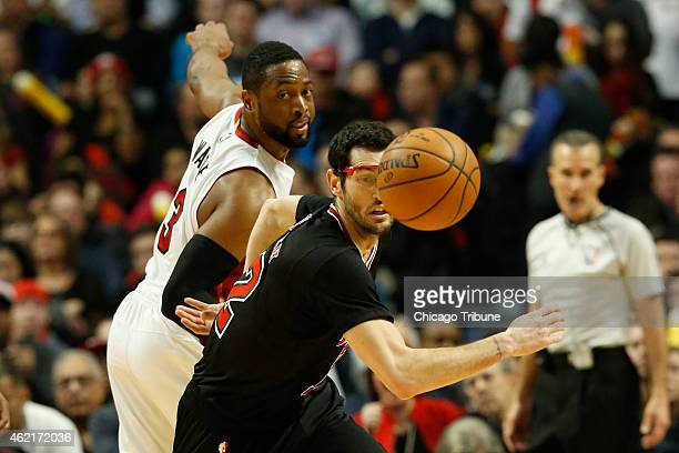 Chicago Bulls guard Kirk Hinrich knocks the ball down in front of Miami Heat guard Dwyane Wade during the second quarter on Sunday Jan 25 at the...