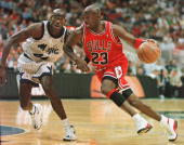 Chicago Bulls guard Michael Jordan drives past Orlando Magic forward Charles Outlaw for two points during the first period of the game at the Arena...