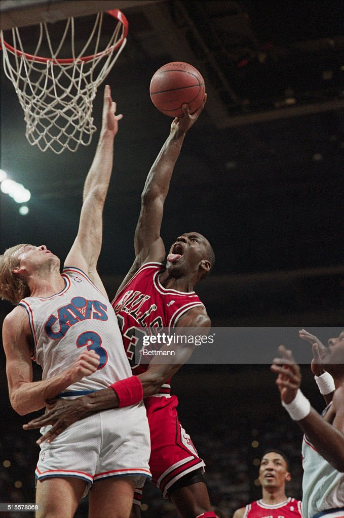 Chicago Bulls guard <a gi-track='captionPersonalityLinkClicked' href=/galleries/search?phrase=Michael+Jordan+-+Basketball+Player&family=editorial&specificpeople=73625 ng-click='$event.stopPropagation()'>Michael Jordan</a> shoots the basketball over his defender, Craig Ehlo of the Cleveland Cavaliers. Richfield, Ohio, April 16, 1989.