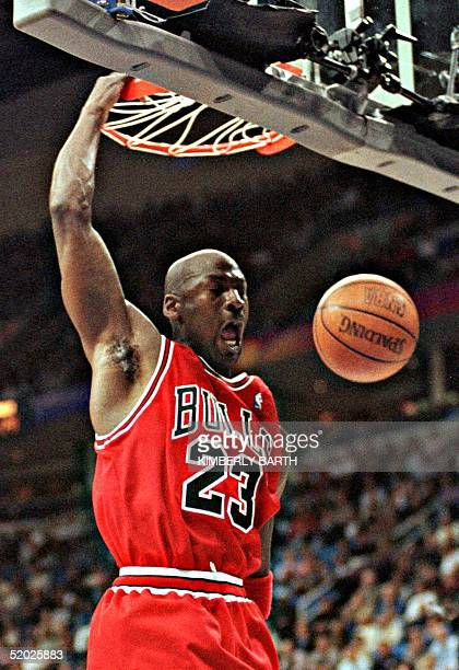 Chicago Bulls guard Michael Jordan slams a basket for two points in the first half 09 April at Gund Arena in Cleveland OH