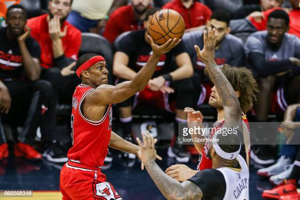 Chicago Bulls guard Rajon Rondo drives to the basket against New Orleans Pelicans forward DeMarcus Cousins during the game between the New Orleans...