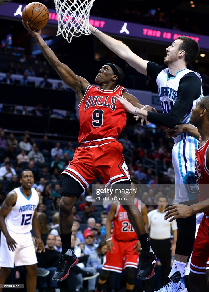 Chicago Bulls guard Rajon Rondo, left, drives to the basket for two points as Charlotte Hornets forward/center, Frank Kaminsky attempts to block the shot during first half action on Monday, March 13, 2017 at the Spectrum Center in Charlotte, N.C.