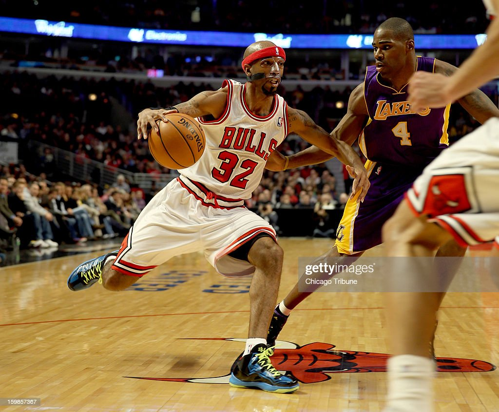 Chicago Bulls guard Richard Hamilton drives to the basket against Los Angeles Lakers Antawn Jamison at the United Center on Monday, January 21, 2013 in Chicago, Illinois.