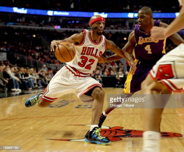Chicago Bulls guard Richard Hamilton drives to the basket against Los Angeles Lakers Antawn Jamison at the United Center on Monday January 21 2013 in...