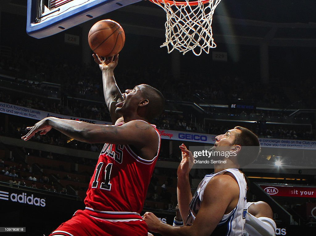 Chicago Bulls guard Ronnie Brewer (11) drives a lay-up past Orlando Magic forward Ryan Anderson (33) during game action at Amway Center in Orlando, Florida, Friday, March 4, 2011. The Bulls beat the Magic, 89-81.